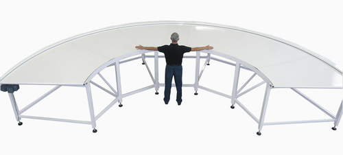 CURVED CONVEYOR WITH CYLINDRICAL END ROLLERS